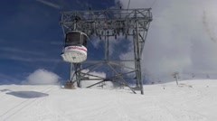 Cable car that climbs passing through the giant metal poles on the steep slop Stock Footage