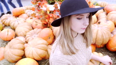 Beautiful woman portrait wearing hat at the autumn fair Stock Footage