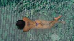 Girl relaxing in the pool Stock Footage