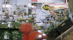 4K Off duty astronaut doing his grocery shopping at the supermarket Stock Footage