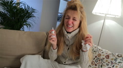 A woman with fever and runny nose using nasal spray and sneezes loudly. Stock Footage