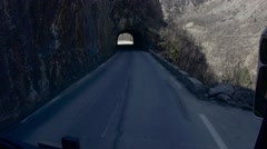 Driving on roads in serpentine and dark tunnels that cross the mountains Stock Footage