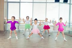 Happy children dancing on in hall, healthy life, kid's togethern Stock Photos