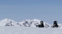 Installation of ski lift that moves above a slope where a plate snownoard was Stock Footage