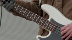 Guitarist learned the outdoor stage during a concert 32p Stock Footage