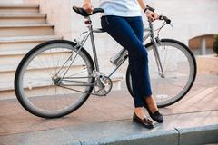 Cropped image of a female biker sitting on bicycle Stock Photos