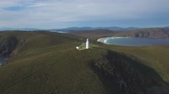 Orbit flight around Bruny Island Lighthouse revealing magnificent coastline Stock Footage