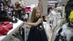 Shopping little Girls In Clothes Store Stock Footage