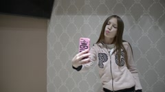 Cute Kid Girl Posing Taking Selfie Shots In New Clothes Store Stock Footage