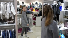Girl Shopping in Store, posing Looking To The Mirror Stock Footage