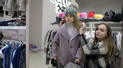 Mom and little Girl Shopping in Store, posing Looking To The Mirror Stock Footage