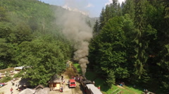 Aerial view of old traditional steam engine locomotive called MOCANITA Stock Footage
