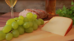 Hard cheese on a wooden table Stock Footage