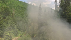 Smoke generated from  old train puffing Stock Footage