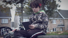 4k Sport Outdoor Child with Bicycle Checking his Tablet Stock Footage