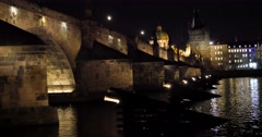 City lights reflicting in Vltava river, The Charles Bridge and it's western t Stock Footage