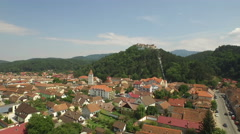 Aerial View of Rasnov city with its Fortress on the background Stock Footage