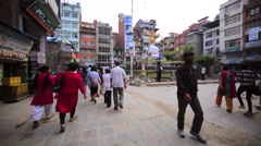Walking in Kathmandu. Pavement destroyed by earthquake, workers paint a statue. Stock Footage