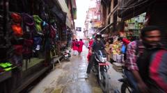 Street market in Kathmandu, capital of Nepal. Walking along the aisle Stock Footage