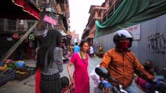 Walking in street market in Kathmandu. Some buildings destroyed after earthquake Stock Footage