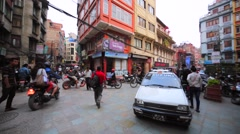 View of busy street. Many bikers drive along the street in Kathmandu. Nepal Stock Footage