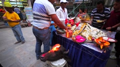 People take food prepared for Nepali New Year celebration. Cow scull with candle Stock Footage
