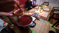 Unidentified man pours russian borshch soup in plate. Russian party in Kathmandu Stock Footage