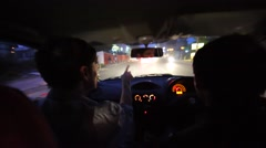 A taxi driver with a tourist takes the city tour of night Kathmandu. Nepal Stock Footage