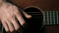 Guitar player's hand touching strings. Music performance. 4K close up dolly Stock Footage