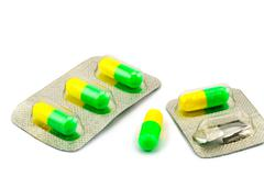Capsule of antibiotic and packages Stock Photos