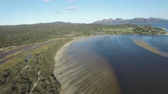 Orbit pan over Swanwick Bay revealing Coles Bay and The Hazards, Tasmania Stock Footage