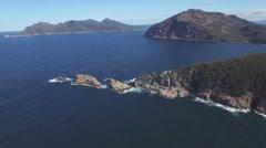 Forward flight over rocks with camera tilt at Freycinet National Park, Tasmania Stock Footage