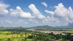 4K time-lapse of white clouds moving over beautiful rural landscape near Hpa-an, Stock Footage