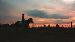 Silhouette of Rider and Horse at Sunset Stock Footage