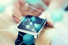 Close up of hands with molecules on smartwatch Kuvituskuvat