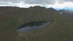 Forward flight over Lake Esperance rising high above mountains in Tasmania Stock Footage