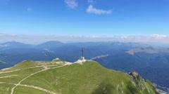 Aerial view of the Heroes Cross on Caraiman Peak, Romania Stock Footage