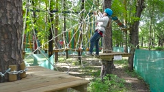 Girl passes a rope obstacle course Stock Footage
