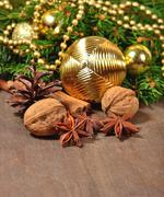Different kinds of spices, nuts, cone and Christmas decorations and spruce br Stock Photos