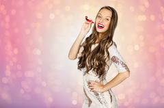 Happy young woman or teen girl with party horn Stock Photos