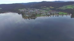Forward flight over Snug Bay towards town of Snug coastline in Tasmania Stock Footage