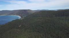 Forward flight over forest towards Eaglehawk Neck near Tasman National Park Stock Footage