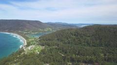 Sideways flight revealing the Eaglehawk Neck, East Coast, Tasmania, Australia Stock Footage