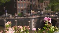 Close up of handlebars and an Amsterdam tour boat passes underneath a bridge Stock Footage