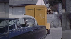 Moving Day Man Sitting in Studebaker 1960s Old Car Vintage Film Home Movie  Stock Footage