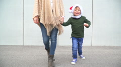 Mother and son with Christmas cap run in the free one Stock Footage
