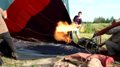 Gas burner blows out hot air and lifts the balloon in the air Stock Footage
