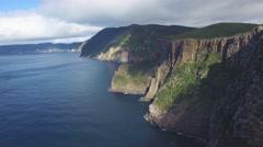 Pan and turn towards cliffs at Cape Hauy in Tasman National Park, Tasmania Stock Footage
