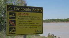 DANGER Crocodiles sign next to East Alligator river in Kakadu, Australia Stock Footage