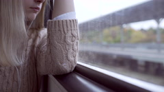 Tired teen girl portrait snuggling the train window and looking outside Stock Footage